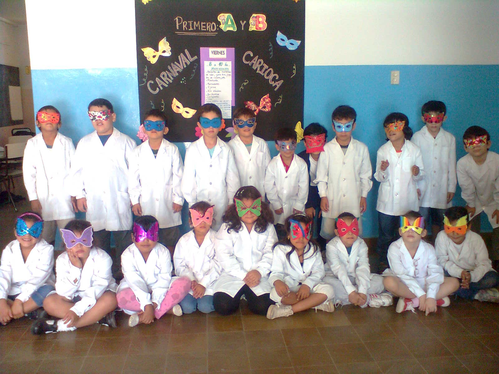 Elementary school students line up wearing lab coats and butterfly masks